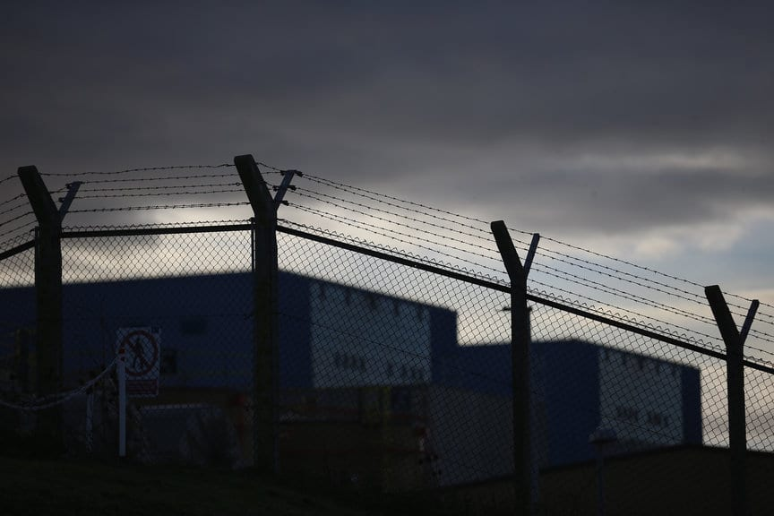 BRIDGWATER, ENGLAND - NOVEMBER 12: Hinkley Point A is seen behind barbed wire at the Electricite de France SA's (EDF) Hinkley Point nuclear power station site, near Bridgwater on November 12, 2013 in Somerset, England. EDF, who last month announced it was to construct a new plant at Hinkley Point after reaching a deal with the U.K. government, said today that energy bills will rise by 3.9 percent on average. (Photo by Matt Cardy/Getty Images)